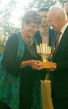 Ada receives the Israeli President's Award for Volunteerism